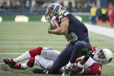 Dec 24, 2016; Seattle, WA, USA;  Seattle Seahawks wide receiver Tyler Lockett (16) is injured as he is tackled by Arizona Cardinals cornerback Brandon Williams (26) during the second quarter at CenturyLink Field. Mandatory Credit: Troy Wayrynen-USA TODAY Sports