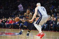Dec 26, 2016; Auburn Hills, MI, USA; Cleveland Cavaliers guard Kay Felder (20) dribbles the ball as Detroit Pistons center Aron Baynes (12) defends during the second quarter at The Palace of Auburn Hills. Mandatory Credit: Tim Fuller-USA TODAY Sports