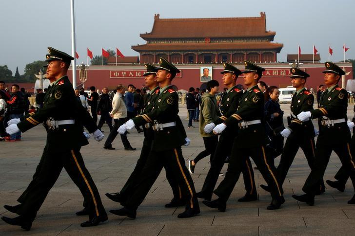 Paramilitary police officers march across Tiananmen Square on the second day of plenary sessions of the 18th Central Committee of the Communist Party of China (CPC) in Beijing, China, October 25, 2016. REUTERS/Thomas Peter/Files