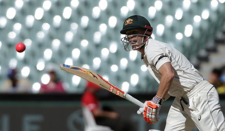 Australian batsman David Warner plays a shot during the fourth day of the Third Test cricket match in Adelaide. REUTERS/Jason Reed