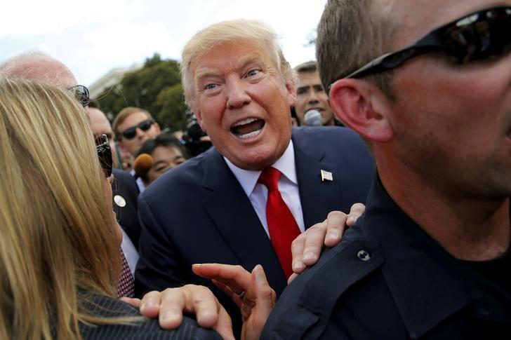 FILE PHOTO  - U.S. Republican presidential candidate Donald Trump makes his way through the crowd after addressing a Tea Party rally against the Iran nuclear deal at the U.S. Capitol in Washington September 9, 2015. REUTERS/Jonathan Ernst/File Photo