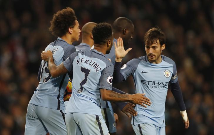 Britain Football Soccer - Manchester City v Arsenal - Premier League - Etihad Stadium - 18/12/16 Manchester City's Leroy Sane celebrates scoring their first goal with team mates Action Images via Reuters / Carl Recine Livepic