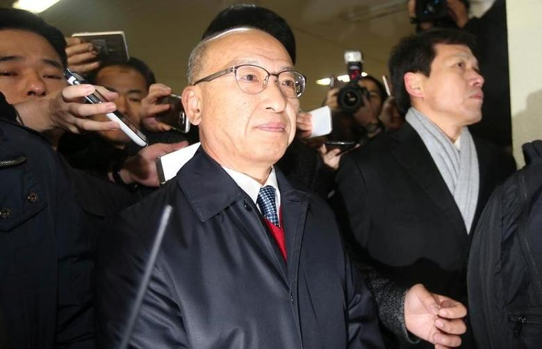 The National Pension Service (NPS) Chairman Moon Hyung-pyo is summoned to the Independent Counsel Team in Seoul, South Korea, December 27, 2016. News1 via REUTERS