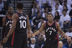 December 28, 2016; Oakland, CA, USA; Toronto Raptors guard Kyle Lowry (7) is congratulated by guard DeMar DeRozan (10) during the third quarter against the Golden State Warriors at Oracle Arena. The Warriors defeated the Raptors 121-111. Mandatory Credit: Kyle Terada-USA TODAY Sports