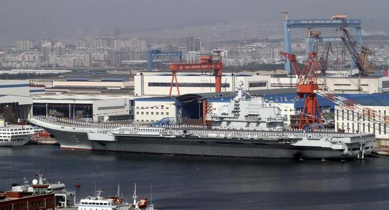 A general view shows navy soldiers standing on China's first aircraft carrier ''Liaoning'' as it is berthed in a port in Dalian, northeast China's Liaoning province, September 25, 2012. REUTERS/Stringer