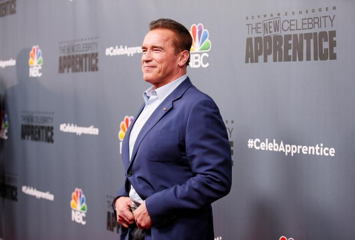 Host Arnold Schwarzenegger poses after a panel for ''The New Celebrity Apprentice'' in Universal City, California, December 9, 2016. REUTERS/Danny Moloshok