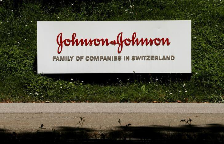 The logo of healthcare company Johnson & Johnson is seen in front of an office building in Zug, Switzerland July 20, 2016.     REUTERS/Arnd Wiegmann/Files