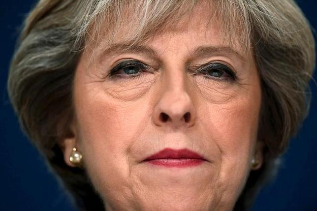 FILE PHOTO: Britain's Prime Minister Theresa May speaks at the annual Conservative Party Conference in Birmingham, Britain, October 2, 2016. REUTERS/Toby Melville/File Photo