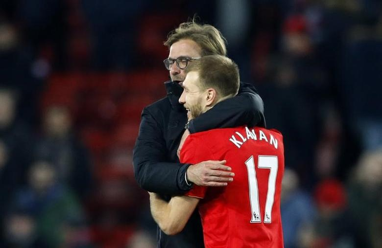 Britain Football Soccer - Liverpool v Manchester City - Premier League - Anfield - 31/12/16 Liverpool manager Juergen Klopp and Liverpool's Ragnar Klavan celebrate after the game  Reuters / Phil Noble Livepic