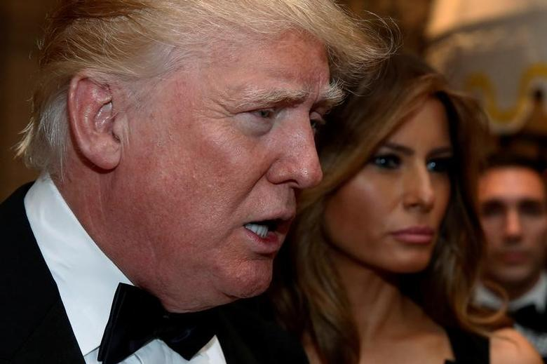 File Photo: U.S. President-elect Donald Trump talks to reporters as he and his wife Melania Trump arrive for a New Year's Eve celebration with members and guests at the Mar-a-lago Club in Palm Beach, Florida, U.S. December 31, 2016. REUTERS/Jonathan Ernst/File Photo