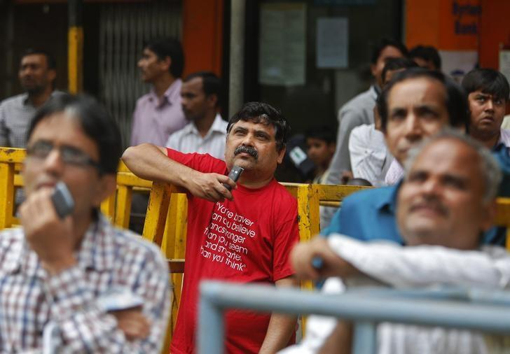 People look at a screen displaying the Sensex on the facade of the Bombay Stock Exchange (BSE) building in Mumbai February 28, 2015. REUTERS/Shailesh Andrade/Files
