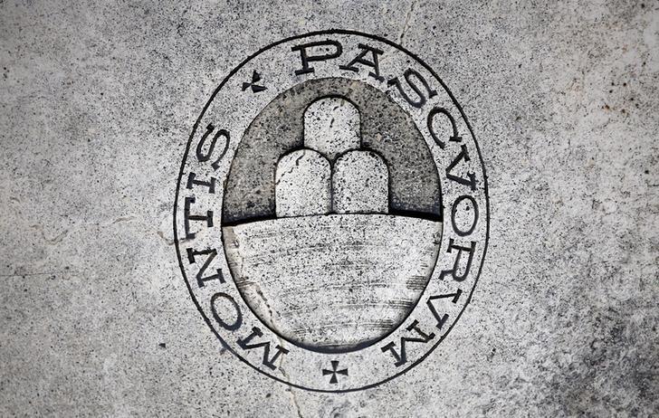 A logo of Monte dei Paschi di Siena bank is seen on the ground in Siena, Italy, November 5, 2014. REUTERS/Giampiero Sposito