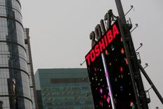 FILE PHOTO -  Workers prepare the New Year's eve numerals above a Toshiba sign in Times Square in Manhattan, New York City, U.S., December 26, 2016.   REUTERS/Andrew Kelly