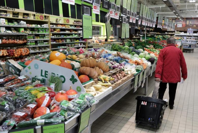 A customer walks past the fruits and vegetables section in a Casino supermarket in Mouans Sartoux, France, October 27, 2016.    REUTERS/Eric Gaillard