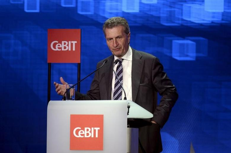 Guenther Oettinger, European Commissioner for Digital Economy and Society, speaks during the welcome night at the world's biggest computer and software fair CeBit in Hanover, Germany, March 14, 2016. REUTERS/Nigel Treblin/Files