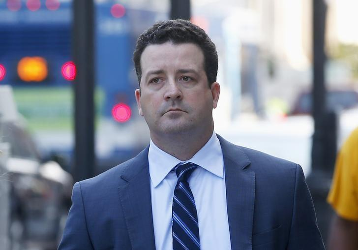 Jesse Litvak, a former managing director at Jefferies Group Inc., walks to U.S. District Court in for his hearing New Haven, Connecticut July 23, 2014.  REUTERS/Mike Segar