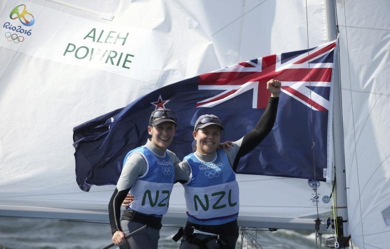 2016 Rio Olympics - Sailing - Final - Women's Two Person Dinghy - 470 - Medal Race - Marina de Gloria - Rio de Janeiro, Brazil - 18/08/2016. Jo Aleh (NZL) of New Zealand and Polly Powrie (NZL) of New Zealand celebrate silver medal.  REUTERS/Benoit Tessier