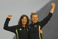 2016 Rio Olympics - Sailing - Victory Ceremony - Women's Two Person Dinghy - 470 - Victory Ceremony - Marina de Gloria - Rio de Janeiro, Brazil - 18/08/2016. Jo Aleh (NZL) of New Zealand and Polly Powrie (NZL) of New Zealand celebrate silver medal. REUTERS/Brian Snyder
