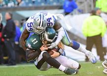 Jan 1, 2017; Philadelphia, PA, USA; Dallas Cowboys defensive end Randy Gregory (94) sacks Philadelphia Eagles quarterback Carson Wentz (11) during the third quarter at Lincoln Financial Field. The Eagles defeated the Cowboys, 27-13.  Eric Hartline-USA TODAY Sports