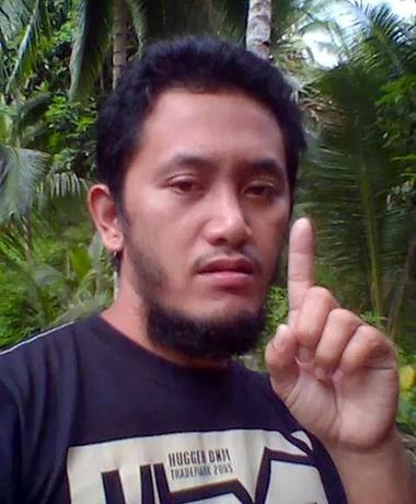Mohammad Jaafar Maguid, leader of a militant group supporting Islamic State, gestures in a remote village at Mindanao province, Philippines in this undated handout picture released by the Philippine National Police. Philippine National Police/Handout via Reuters