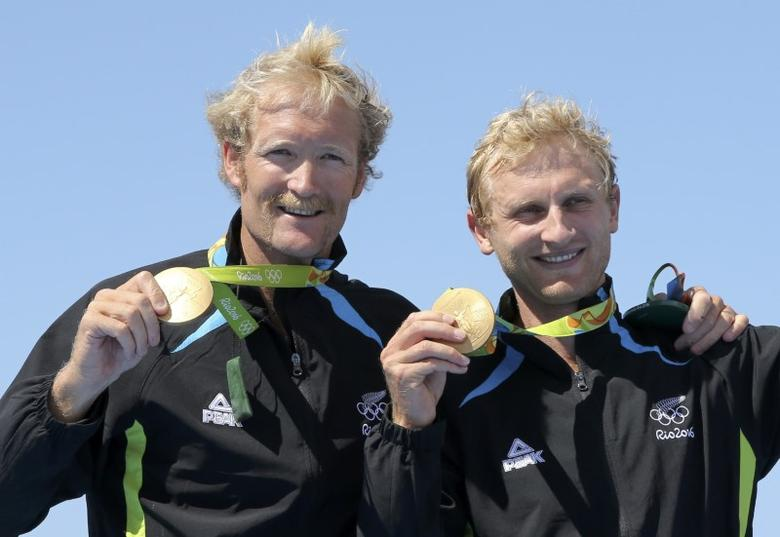 2016 Rio Olympics - Rowing - Victory Ceremony - Men's Pair Victory Ceremony - Lagoa Stadium - Rio De Janeiro, Brazil - 11/08/2016. Eric Murray (NZL) of New Zealand and Hamish Bond (NZL) of New Zealand pose with their gold medals. REUTERS/Gonzalo Fuentes