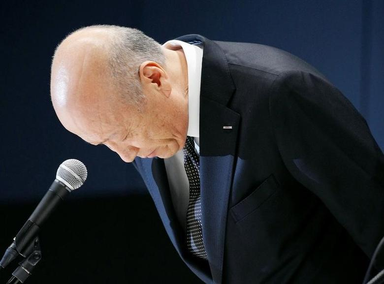 Tadashi Ishii, president of Japan's top advertising agency Dentsu Inc, bows during a news conference in Tokyo, Japan, in this photo taken by Kyodo December 28, 2016. Picture taken December 28, 2016. Mandatory credit Kyodo/via REUTERS