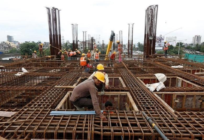 Labourers work at the construction site of a metro rail station in Kolkata, India August 31, 2016. REUTERS/Rupak De Chowdhuri/Files