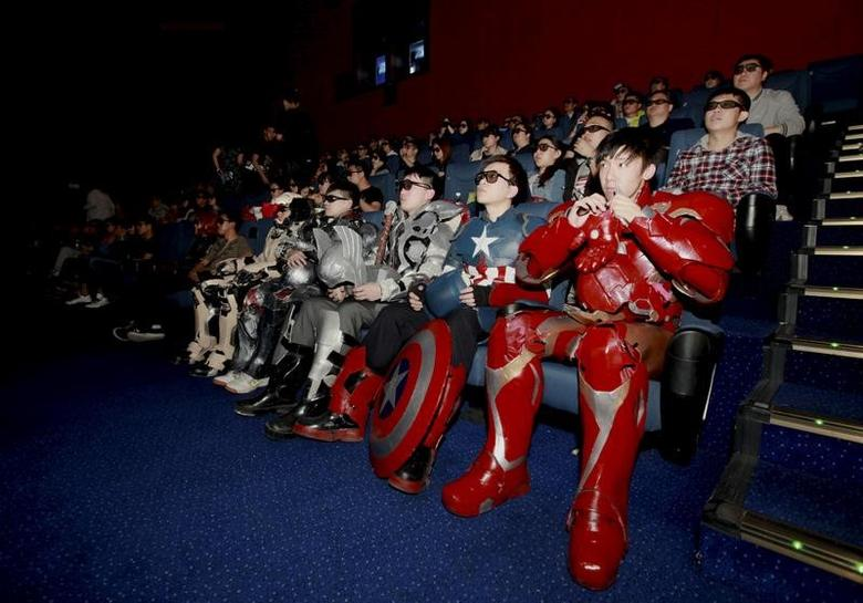 A group of fans dressed in homemade replica armour of ''Avengers: Age of Ultron'' movie characters, Iron Man, Captain America and Thor, watch the film in a theatre in Changchun, Jilin province, China on May 16, 2015.   REUTERS/Stringer