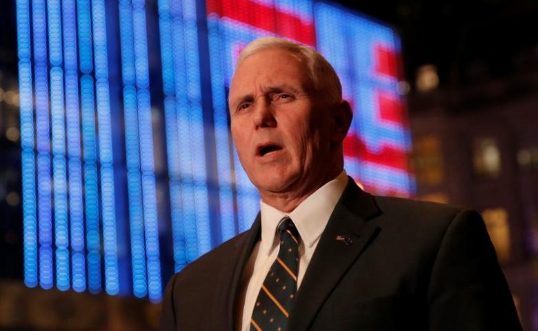 U.S. Vice President-elect Mike Pence speaks to reporters as he exits Trump Tower in New York, U.S., January 6, 2017. REUTERS/Mike Segar