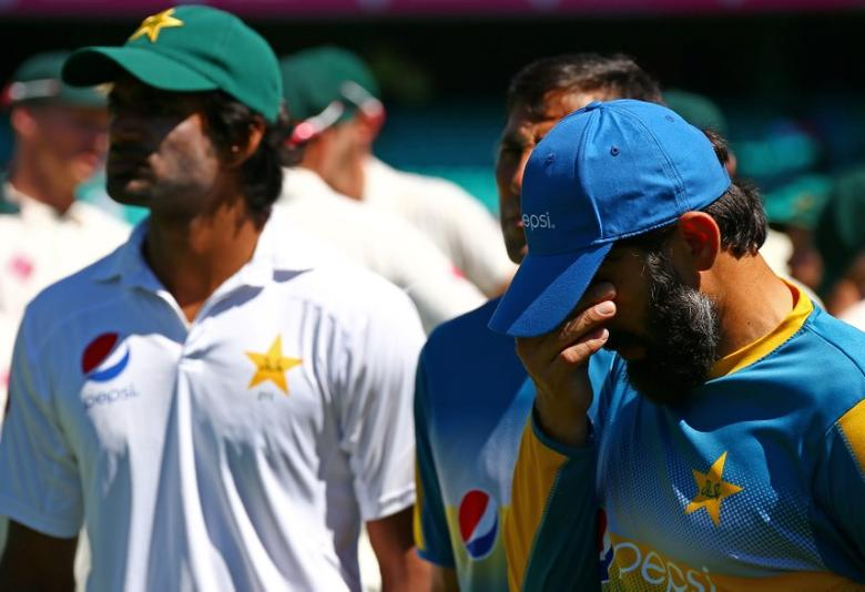 Cricket - Australia v Pakistan - Third Test cricket match - Sydney Cricket Ground, Sydney, Australia - 7/1/17 Pakistan's captain Misbah-ul-Haq reacts during the trophy presentation. REUTERS/David Gray