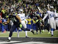 January 7, 2017; Seattle, WA, USA; Seattle Seahawks running back Thomas Rawls (34) runs the ball in for a touchdown against the Detroit Lions during the second half in the NFC Wild Card playoff football game at CenturyLink Field. Mandatory Credit: Steven Bisig-USA TODAY Sports