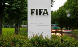 Cars drive past a logo in front of FIFA's headquarters in Zurich, Switzerland June 8, 2016. REUTERS/Arnd Wiegmann - RTSGJA3
