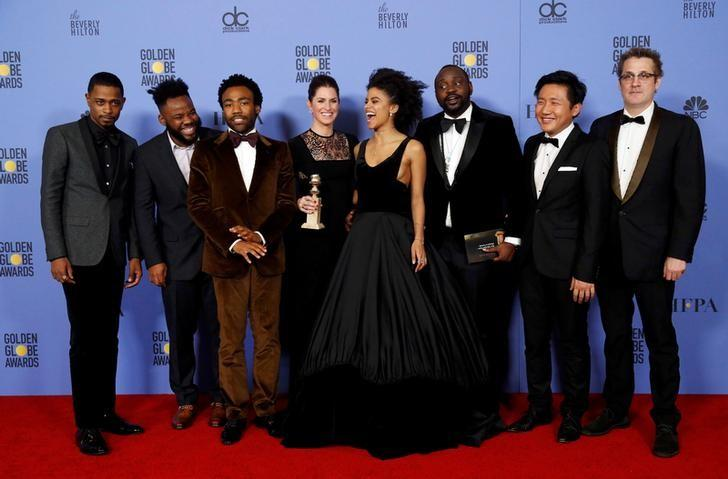 The cast and producers of the television comedy ''Atlanta'' pose with the award for Best Television Series - Musical or Comedy during the 74th Annual Golden Globe Awards in Beverly Hills, California, U.S., January 8, 2017. REUTERS/Mario Anzuoni
