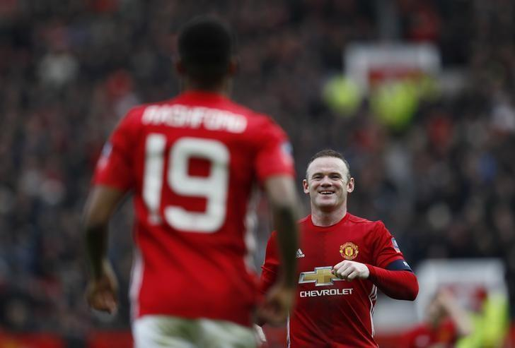 Britain Football Soccer - Manchester United v Reading - FA Cup Third Round - Old Trafford - 7/1/17 Manchester United's Marcus Rashford celebrates scoring their third goal with Wayne Rooney Action Images via Reuters / Jason Cairnduff Livepic/Files