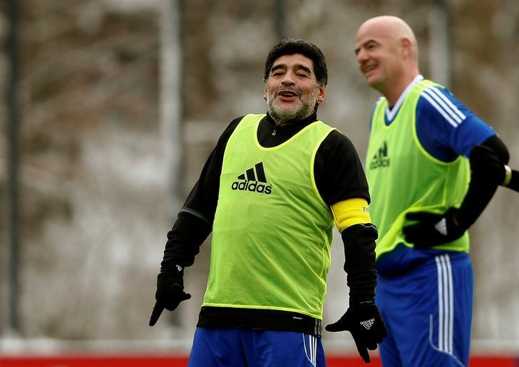 Diego Armando Maradona (L) stands in front of FIFA President Gianni Infantino during the FIFA Legends tournament ahead of the FIFA awards ceremony in Zurich, Switzerland, January 9, 2017. REUTERS/Arnd Wiegmann