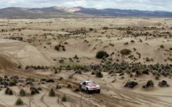 Dakar Rally - 2017 Paraguay-Bolivia-Argentina Dakar rally - 39th Dakar Edition - Seventh stage from Oruro to Uyuni, Bolivia 09/01/17. Stephane Peterhansel and co-pilot Jean Paul Cottret, both of France, drive their Peugeot . REUTERS/Martin Mejia/Pool