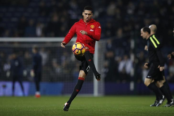 Britain Football Soccer - West Bromwich Albion v Manchester United - Premier League - The Hawthorns - 17/12/16 Manchester United's Chris Smalling warms up before the match  Reuters / Phil Noble Livepic/Files