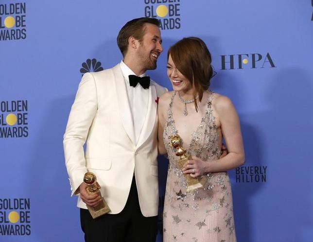 Ryan Gosling and Emma Stone pose with their awards for Best Performance by an Actor in a Motion Picture - Musical or Comedy and Best Performance by an Actress in a Motion Picture - Musical or Comedy for their roles in ''La La Land'' during the 74th Annual Golden Globe Awards in Beverly Hills, California, U.S., January 8, 2017.  REUTERS/Mario Anzuoni