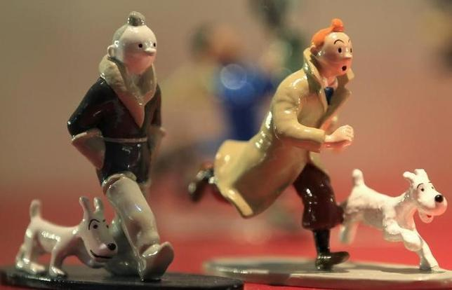 Figurines from the comic strip Tintin by Brussels-born author Georges Remi, better known as Herge, are displayed in a shop at the Herge Museum in Louvain-La-Neuve December 1, 2011.  REUTERS/Yves Herman/Herge-Moulinsart/Files