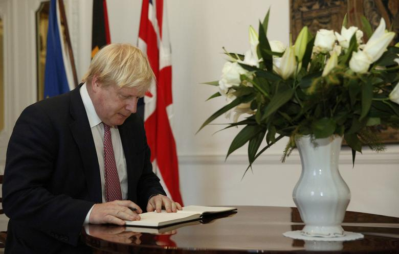 Britain's Foreign Secretary Boris Johnson signs a book of condolence for victims of the Berlin truck attack, at the German embassy in London, Britain December 21, 2016. REUTERS/Neil Hall