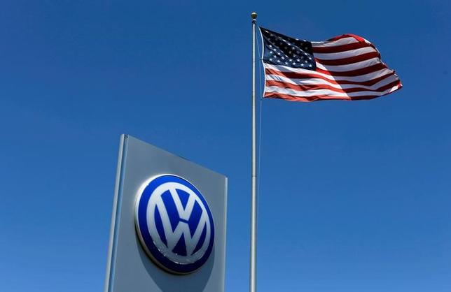 A U.S. flag flutters in the wind above a Volkswagen dealership in Carlsbad, California, U.S. May 2, 2016. REUTERS/Mike Blake/File Photo