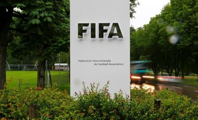 Cars drive past a logo in front of FIFA's headquarters in Zurich, Switzerland June 8, 2016. REUTERS/Arnd Wiegmann/Files