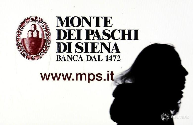 A Monte dei Paschi di Siena advertisement is seen on a screen in a bank window in downtown Milan, Italy, January 14, 2016. REUTERS/Stefano Rellandini/File Photo