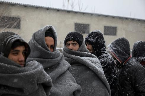 Migrants out in the cold