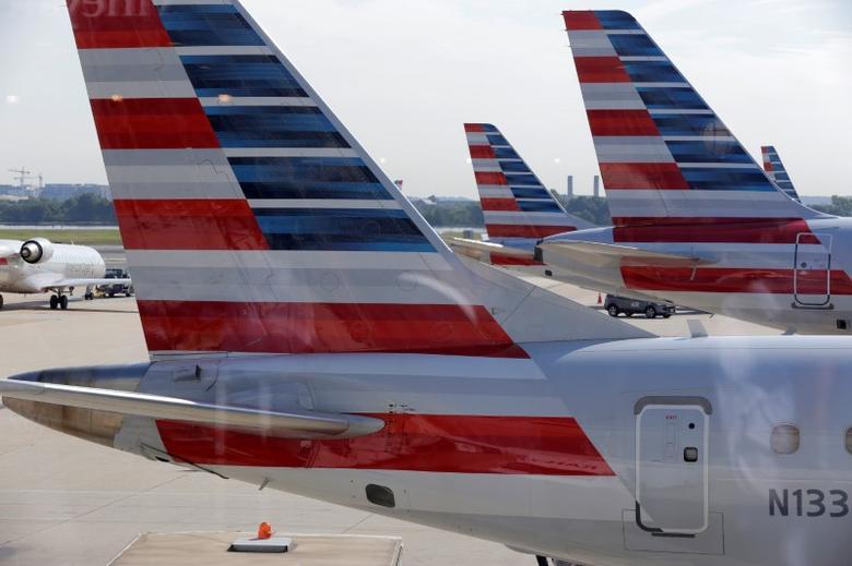 American Airlines aircraft are parked at Ronald Reagan Washington National Airport in Washington, U.S., August 8, 2016.      REUTERS/Joshua Roberts