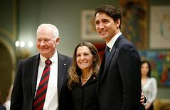Chrystia Freeland poses with Canada's Governor General David Johnston (L) and Prime Minister Justin Trudeau after being sworn-in as Canada's foreign affairs minister during a cabinet shuffle at Rideau Hall in Ottawa, Ontario, Canada, January 10, 2017. REUTERS/Chris Wattie