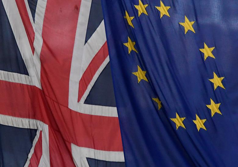 FILE PHOTO: A Union flag flies next to the flag of the European Union in London, Britain, November 4, 2016. REUTERS/Toby Melville/File Photo