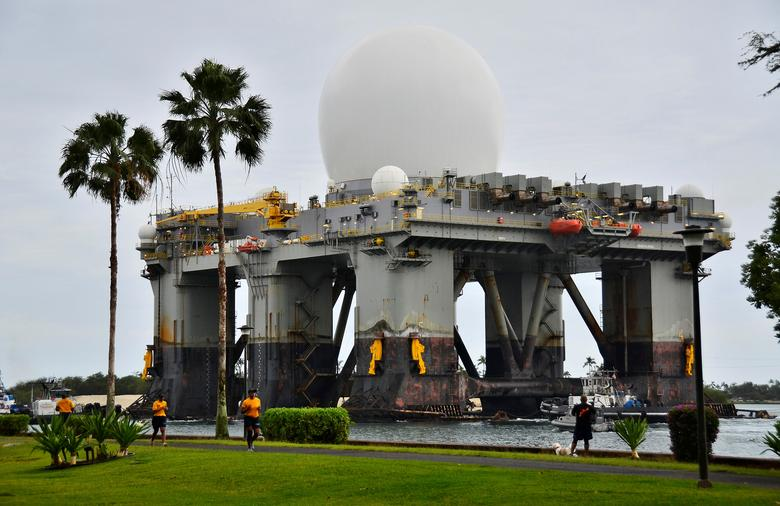 The Sea-based, X-band Radar (SBX 1), a combination of the world's largest phased-array X-band radar carried aboard a mobile, ocean-going semi-submersible oil platform, transits the waters of Joint Base Pearl Harbor-Hickam, Hawaii, U.S. on March 22, 2013.  Courtesy Daniel Barker/U.S. Navy/Handout via REUTERS