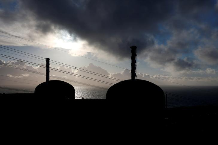 FILE PHOTO Nuclear Power Plant 1 and 2 units are silhouetted November 16, 2016 at sunset in Flamanville, France. REUTERS/Benoit Tessier/File Photo