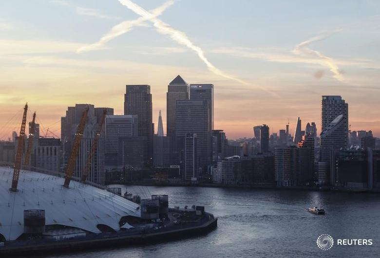 Canary Wharf and the city are seen at sunset in London, December 14, 2016.        REUTERS/Eddie Keogh   - RTX2V1A9